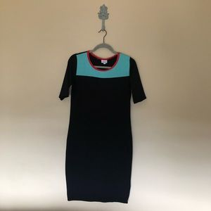Black dress with green on chest